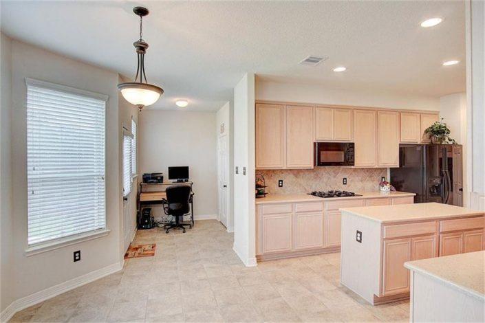 Interior paint job and baseboard upgrade of dining area and kitchen in Cypress, TX