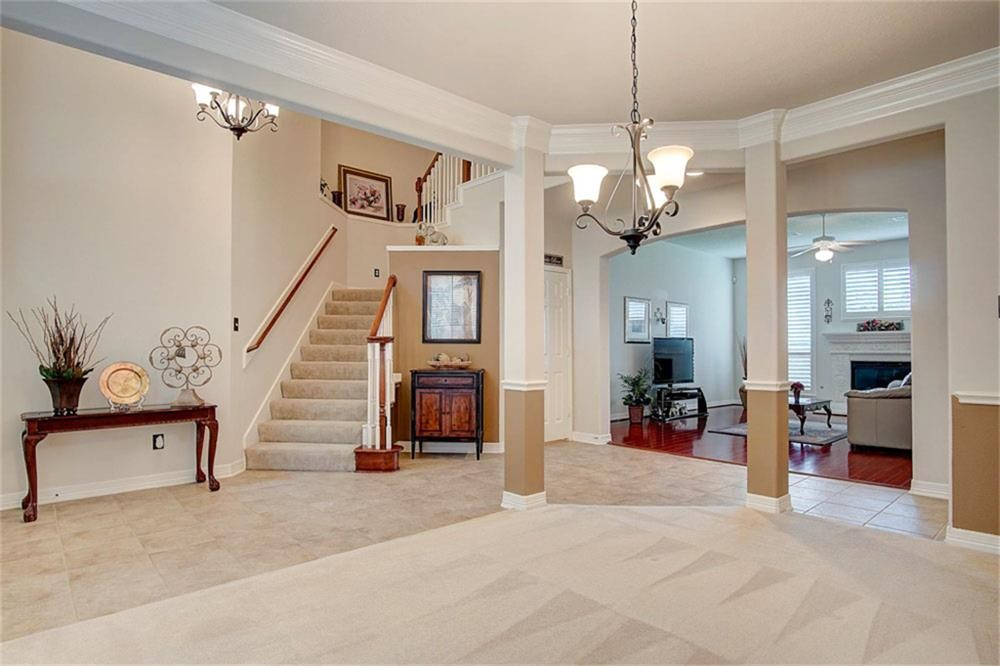 living room interior paint job and crown molding installation in cypress tx