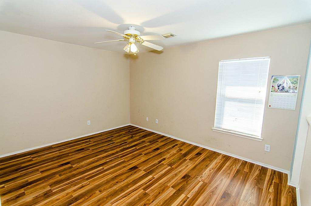Interior Remodel including Wood Flooring and Repaint of Richmond, TX Bedroom