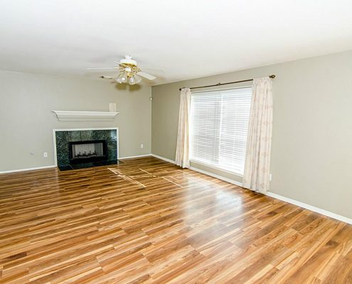 Remodeled Interior Including Wood Flooring and Paint Job in Richmond, TX Living Room